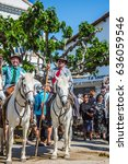 Small photo of Sent-Mari-de-la-Mer, Provence, France - May 25, 2015. Two guards on white horses are waiting for the parade. World Gypsy Festival. The concept of ethnographic and active tourism