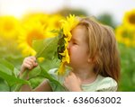 happy little girl smelling a... | Shutterstock . vector #636063002