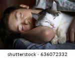 Stock photo teen boy sleep with cat in bed hug close up photo 636072332