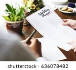 hands holding wedding planner... | Shutterstock . vector #636078482
