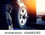 Repairman Balances The Wheel...