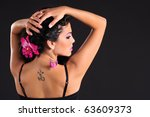 Sexy brunette with tattoo on her back - stock photo