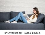 beautiful young woman reading... | Shutterstock . vector #636115316
