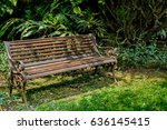 Rusty Metal Park Bench On Gree...