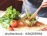 woman cooking mixing salad | Shutterstock . vector #636205046