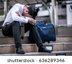 stressed businessman sitting at