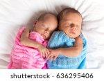 Newborn Twins Sleeping On Bed...
