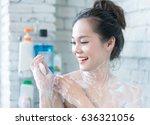 asian women are taking a shower ... | Shutterstock . vector #636321056