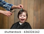 a little boy is trimmed in the... | Shutterstock . vector #636326162