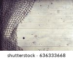 Fishing nets still-life on the wooden background.   - stock photo
