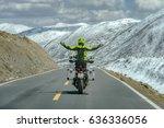 Men Standing On Motorbike Whil...