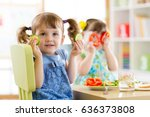 happy kids eating healthy food... | Shutterstock . vector #636373808