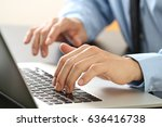 Close Up Of Businessman Typing...