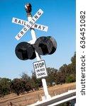 a railway crossing signal in... | Shutterstock . vector #636451082