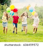 four glad kids happily playing... | Shutterstock . vector #636459572