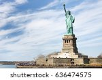 the statue of liberty and... | Shutterstock . vector #636474575