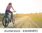 girl riding a bicycle in the... | Shutterstock . vector #636484892