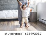 a father teaching a baby to... | Shutterstock . vector #636493082