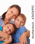 mom with her two children on a... | Shutterstock . vector #63656992