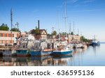 sailing ships moored in... | Shutterstock . vector #636595136