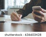 businessman analyzing graph... | Shutterstock . vector #636603428