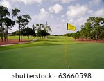manicured golf green and fairway - stock photo