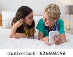 siblings listening to music... | Shutterstock . vector #636606596