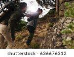 female hiker helping her... | Shutterstock . vector #636676312