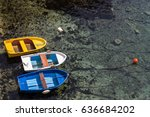 three fishing boats moored to... | Shutterstock . vector #636684202