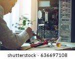 man repairman is trying to fix... | Shutterstock . vector #636697108