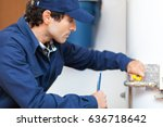 plumber repairing an hot water... | Shutterstock . vector #636718642