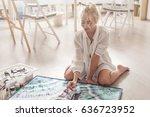 beautiful young woman sitting...   Shutterstock . vector #636723952