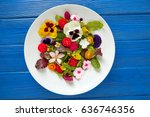 edible flowers salad in a plate ... | Shutterstock . vector #636746356