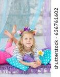 lovely girl with a unicorn hoop ... | Shutterstock . vector #636761602
