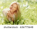 girl with a dandelion in his... | Shutterstock . vector #636775648