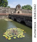 Small photo of Entrance to the Intramuros Fort Santiago with a defense moat and the stone bridge, Manila, Philippines