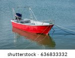 A Small Red Color Dinghy With ...