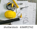 construction plans with helmet... | Shutterstock . vector #636892762