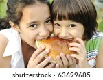 Closeup Of Two Children Eating...