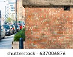 red brick wall with a london... | Shutterstock . vector #637006876