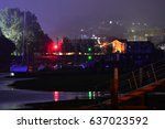lights from the quay reflect... | Shutterstock . vector #637023592