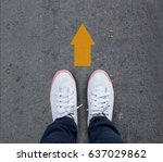 pair of shoes standing on a... | Shutterstock . vector #637029862