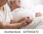 Small photo of Senior caring loving marriage holding hand's in hospital