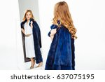 girl with curls posing in fake... | Shutterstock . vector #637075195