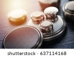 closeup button cell battery or... | Shutterstock . vector #637114168
