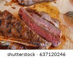 sliced grilled beef steaks on... | Shutterstock . vector #637120246