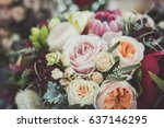 Stock photo roses in a brides flower bouquet 637146295