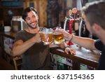 smiling man toasting beer mug...   Shutterstock . vector #637154365