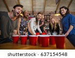 young friends playing beer pong ... | Shutterstock . vector #637154548