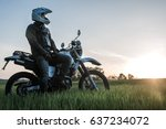 Motorcyclist On Green Grass Of...